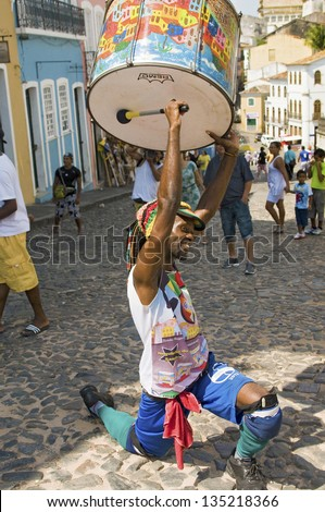 SALVADOR, BRAZIL - DECEMBER 8: Samba street performer holding drum while playing in Pelourinho historic center in Salvador, Brazil on December 8, 2012.