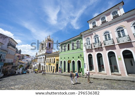 SALVADOR, BRAZIL - MARCH 12, 2015: Pedestrians walk through a plaza surrounded by colonial buildings in the historic district of Pelourinho.