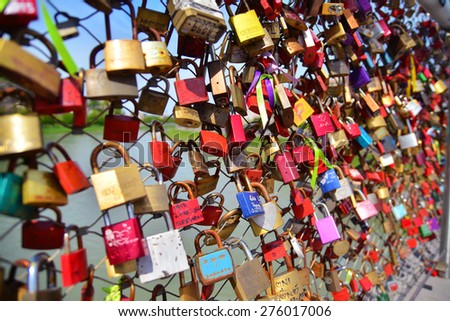 Salzburg, Austria - April 25, 2015: Love locks on the Makartsteg in Salzburg, Austria.  - stock photo