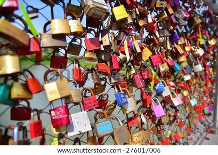 Salzburg, Austria - April 25, 2015: Love locks on the Makartsteg in Salzburg, Austria.  - stock photo