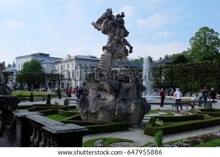 SALZBURG, AUSTRIA. APRIL 29:  Unidentified male and female tourists photograph sculpture in the Mirabell garden. on APRIL 29, 2017 in Mirabell garden Salzburg, Austria.