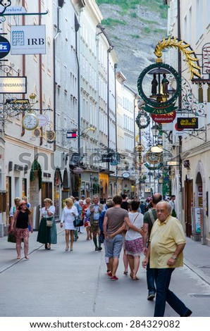 SALZBURG, AUSTRIA - CIRCA SEPTEMBER 2014: People on the streets of historic city centre in Salzburg, Austria. Old town of Salzburg (Altstadt) was listed as a UNESCO World Heritage Site in 1997. - stock photo
