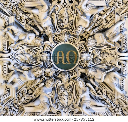 SALZBURG, AUSTRIA - DECEMBER 13: Alpha and Omega, fragment of the dome of Salzburg Cathedral on December 13, 2014. Salzburg Cathedral is renowned for its harmonious Baroque architecture. - stock photo