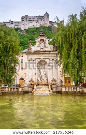 SALZBURG, AUSTRIA - 20 JUNE 2014: Hohensalzburg Castle in the historic centre of  Salzburg city. Old town of Salzburg (Altstadt) was listed as a UNESCO World Heritage Site in 1997.  - stock photo