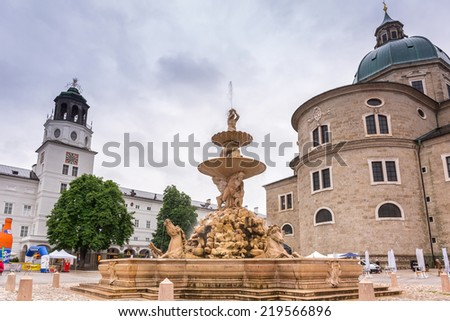 SALZBURG, AUSTRIA - 20 JUNE 2014: People on the streets of historic city centre in Salzburg, Austria. Old town of Salzburg (Altstadt) was listed as a UNESCO World Heritage Site in 1997.