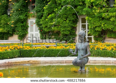 Salzburg, Austria - September 3, 2016: Fountain with a statue of a woman in Mirabell gardens. It is a very popular tourist  place.