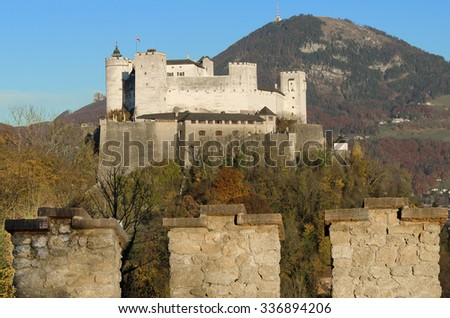 Salzburg fortress Hohensalzburg in Austria and castle wall. Castle in front of Gaisberg mountain on the right and the Nockstein on the left. Festival city for classical music,  birthplace of Mozart.