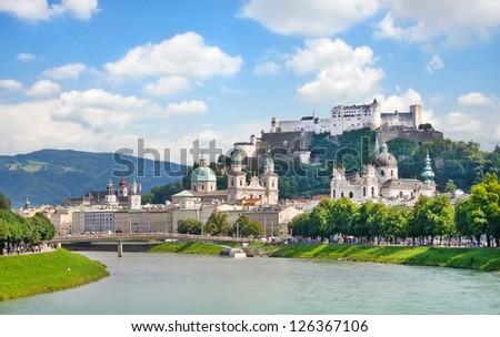 Salzburg skyline with Festung Hohensalzburg and river Salzach, Salzburger Land, Austria - stock photo