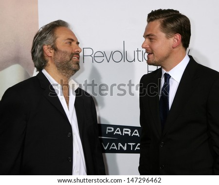 """Sam Mendes & Leonardo DiCaprio arriving at the World Premiere of """"Revolutionary Road"""" at the Mann's Village Theater in Westwood, CA on December 15, 2008 - stock photo"""