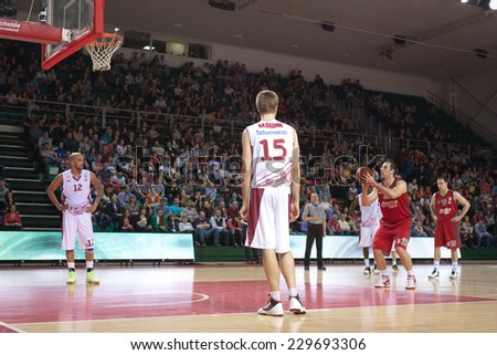 SAMARA, RUSSIA - APRIL 06: Aleksandar Maric of BC Lokomotiv-Kuban gets ready to throw from the free throw line in a BC Krasnye Krylia game on April 06, 2013 in Samara, Russia. - stock photo