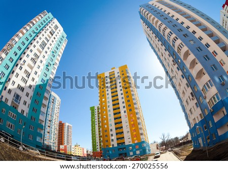 SAMARA, RUSSIA - APRIL 12, 2015: Tall apartment buildings under construction against a blue sky background - stock photo