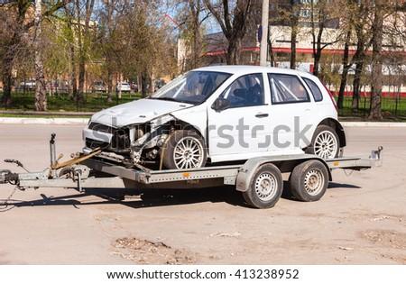 SAMARA, RUSSIA - APRIL 26, 2016: Transportation emergency sport car on the trailer - stock photo