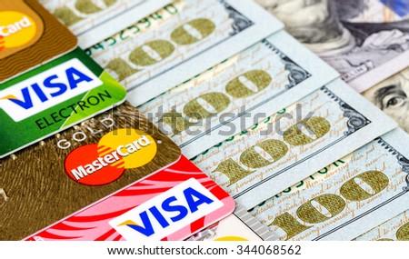 SAMARA, RUSSIA - APRIL 10, 2015: Visa and MasterCard with US dollar bills - stock photo