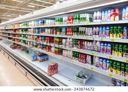 SAMARA, RUSSIA - AUGUST 30, 2014: Fresh milk produces ready for sale in Auchan Samara Store. French distribution network Auchan unites more than 1300 shops - stock photo