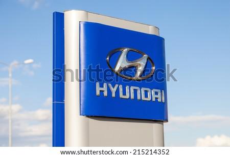 SAMARA, RUSSIA - AUGUST 30, 2014: Hyundai dealership sign against blue sky. Hyundai Motor Company is a South Korean multinational automotive manufacturer headquartered in Seoul, South Korea - stock photo