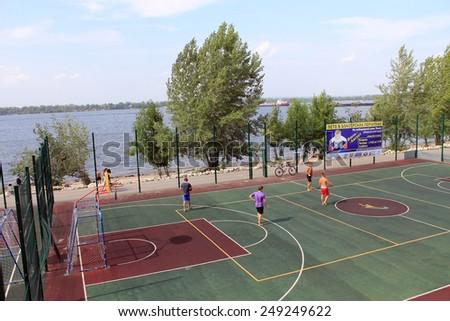 Samara, Russia - August 23, 2014: strangers on the Playground playing ball in Samara, Russia - August 23, 2014. - stock photo