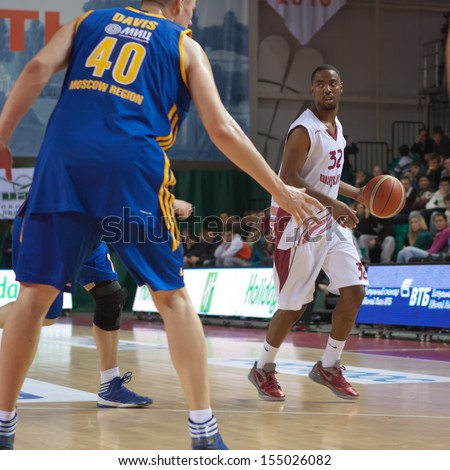 SAMARA, RUSSIA - DECEMBER 17: Aaron Miles of BC Krasnye Krylia, with ball, is on the attack during a BC Khimki game on December 17, 2012 in Samara, Russia. - stock photo