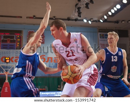 SAMARA, RUSSIA - DECEMBER 11: Aleksei Fedorchuk of BC Krasnye Krylia, with ball, is on the attack during a BC Joensuun Kataja game on December 11, 2012 in Samara, Russia.