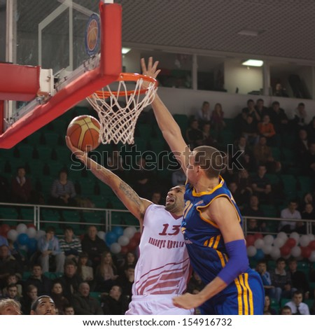 SAMARA, RUSSIA - DECEMBER 17: Chester Simmons of BC Krasnye Krylia throws a ball in a basket during a game against BC Khimki on December 17, 2012 in Samara, Russia. - stock photo