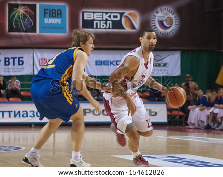 SAMARA, RUSSIA - DECEMBER 17: Chester Simmons of BC Krasnye Krylia with ball tries to go past a BC Khimki player on December 17, 2012 in Samara, Russia. - stock photo