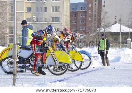 SAMARA, RUSSIA - FEBRUARY 19: A group of winter speedway racers start free practice during Championship Russia on February 19, 2011 in Samara, Russia. - stock photo