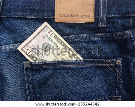 Samara, Russia - February 23, 2015: Calvin Klein jeans company in the back pocket $ 50 - stock photo