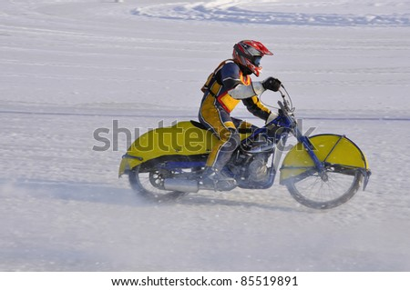 SAMARA, RUSSIA - FEBRUARY 19:  Motorbike with spikes accelerates unidentified rider after the turn of, Speedway on the ice Championship on February 19, 2011 in Samara, Russia - stock photo