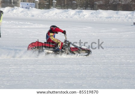 SAMARA, RUSSIA - FEBRUARY 19:  Motorbike with spikes unidentified the driver turns the large slope, Speedway on the ice Championship on February 19, 2011 in Samara, Russia