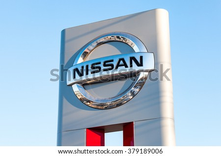 SAMARA, RUSSIA - FEBRUARY 13, 2016: Official dealership sign of Nissan against blue sky. Nissan is a Japanese multinational automaker - stock photo