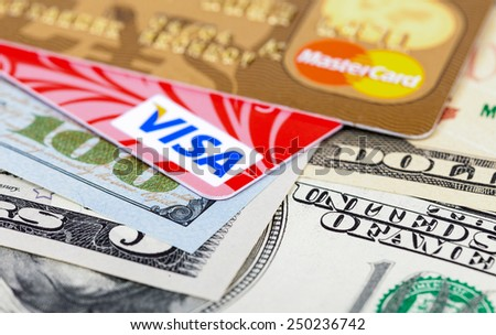 SAMARA, RUSSIA - FEBRUARY 4, 2015: Photo of VISA and Mastercard credit card with american dollars - stock photo