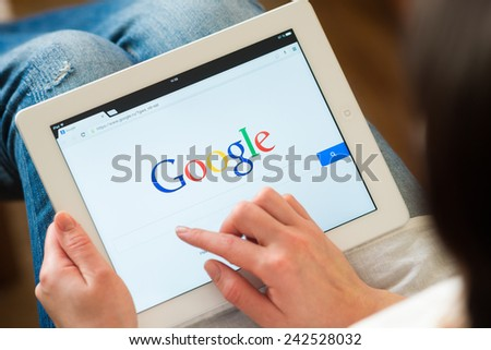 Samara, Russia - January 08, 2015: A Google search home page on a ipad screen, new app for mobile devices - stock photo