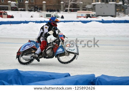 SAMARA, RUSSIA - JANUARY 20: Racer Airat Khabibullin on a motorcycle with spikes on the rear wheel accelerates, ice speedway Cup of Russia January 20, 2013 in Samara, Russia - stock photo