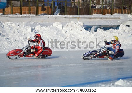 SAMARA, RUSSIA - JANUARY 29: Two rival unidentified motorcyclists on corner exit icy track, ice speedway Cup of Russia January 29, 2012 in Samara, Russia