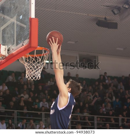 SAMARA, RUSSIA - JANUARY 28: Valiev Evgeny of BC Triumph makes slam dunk in the game against BC Krasnye Krylia on January 28, 2012 in Samara, Russia. - stock photo