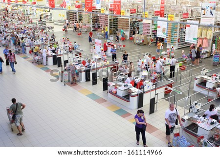 SAMARA, RUSSIA - JULY 7: Shoppers at the checkout lane Auchan hypermarket, July 7, Samara. In Russia there are more than a hundred stores Auchan - stock photo