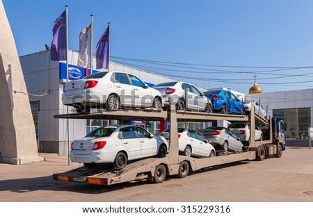 SAMARA, RUSSIA - JULY 23, 2015: Truck brought new cars to car showroom Datsun - stock photo