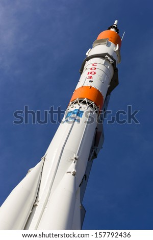 "SAMARA, RUSSIA - JUNE 2: Real ""Soyuz"" type rocket as monument on June 2, 2012 in Samara. Rocket height together with building - 68 meters, weight - 20 tons. The monument was unveiled on 2001 - stock photo"