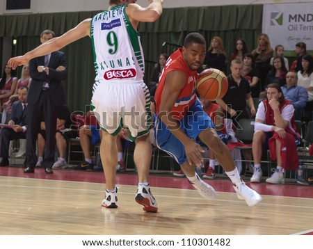 SAMARA, RUSSIA - MARCH 07: Aaron Marquez Miles of BC Krasnye Krylia with ball tries to go past a BC Zalgiris player on March 07, 2012 in Samara, Russia.