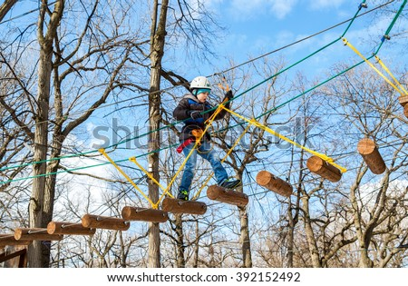 SAMARA, RUSSIA - MARCH 13, 2016: Boy with climbing equipment during the passage of obstacles course - stock photo