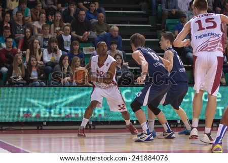 SAMARA, RUSSIA - MAY 03: Aaron Miles of BC Krasnye Krylia, with ball, is on the attack during a BC Triumph game on May 03, 2013 in Samara, Russia. - stock photo