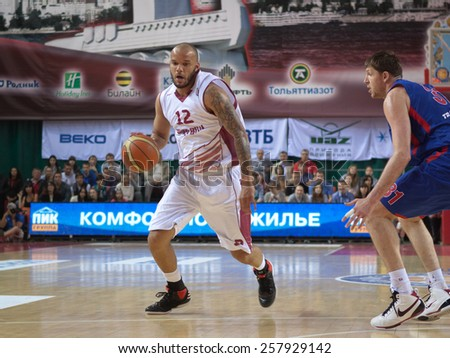 SAMARA, RUSSIA - MAY 20: Andre Smith of BC Krasnye Krylia, with ball, is on the attack during a BC CSKA game on May 20, 2013 in Samara, Russia. - stock photo