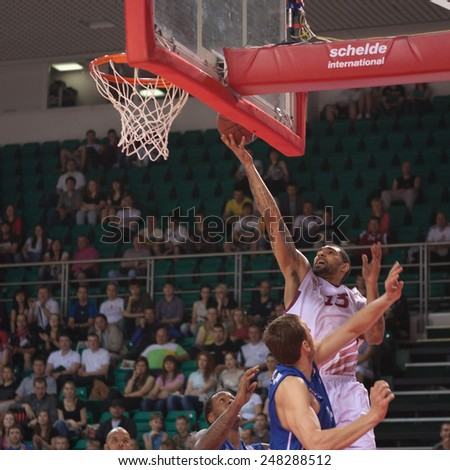 SAMARA, RUSSIA - MAY 11: Chester Simmons of BC Krasnye Krylia throws the ball in a basket during a BC Enisey game on May 11, 2013 in Samara, Russia. - stock photo
