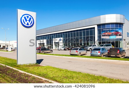 SAMARA, RUSSIA - MAY 14, 2016: Dealership sign and cars parked up near the office building of official dealer Volkswagen. Volkswagen Group is the biggest German automaker