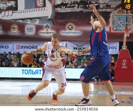 SAMARA, RUSSIA - MAY 20: Evgeny Kolesnikov of BC Krasnye Krylia with ball tries to go past a BC CSKA player on May 20, 2013 in Samara, Russia. - stock photo