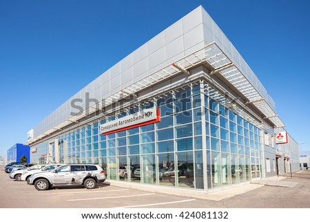 SAMARA, RUSSIA - MAY 14, 2016: New cars parked up near the office building of official dealer Mitsubishi. Mitsubishi Motors Corporation is a multinational automotive manufacturer - stock photo