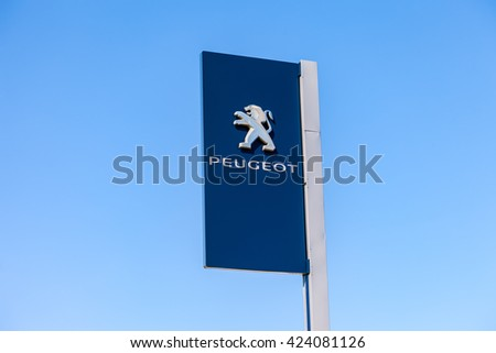 SAMARA, RUSSIA - MAY 14, 2016: Official dealership sign of Peugeot against the blue sky background. Peugeot is a French car brand, automotive manufacturer - stock photo