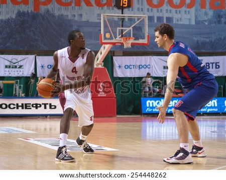 SAMARA, RUSSIA - MAY 19: Omar Thomas of BC Krasnye Krylia with ball goes against a BC CSKA player on May 19, 2013 in Samara, Russia. - stock photo