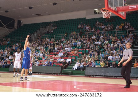SAMARA, RUSSIA - MAY 11: Petr Gubanov of BC Enisey scored a goal from the free throw line in a BC Krasnye Krylia game on May 11, 2013 in Samara, Russia. - stock photo