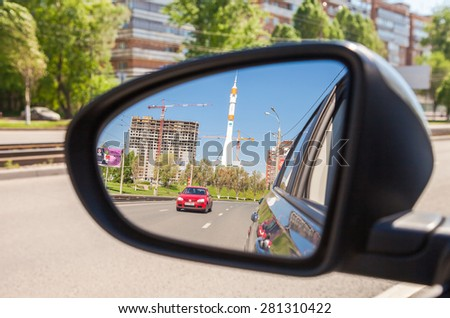 SAMARA, RUSSIA - MAY 23, 2015: Reflection in the rearview mirror of a car - stock photo