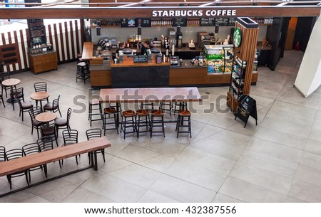 SAMARA, RUSSIA - MAY 22, 2016: Starbucks cafe in Samara Kurumoch airport. Starbucks Corporation is an American global coffee company and coffeehouse chain